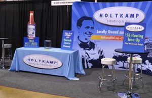 Custom Tablecovers Holtkamp Trade Show Graphics e1536773781167 300x194